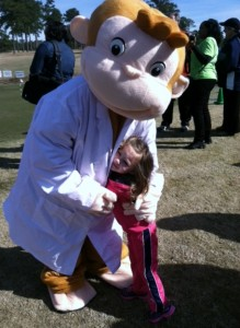 Dr. Bananas and child golf tourney
