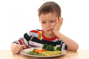 boy and cooked vegetables
