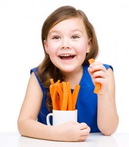 Kid snacks on carrots