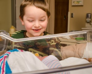 Sibling excited about new baby